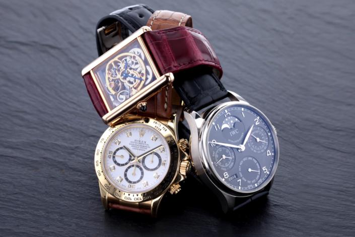 Luxusschmuck und Luxusuhren perfekt fotografiert, Trio aus IWC, Rolex und Philippe Patek